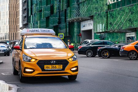 Russia Moscow 2019-06-17 Yandex Taxi yellow car Hyundai with identification lights on the car roof with logo