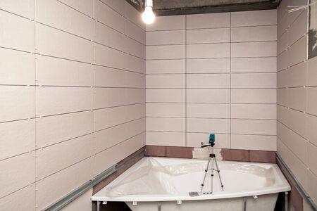 Bathroom interior repair, laying tiles on walls 스톡 콘텐츠