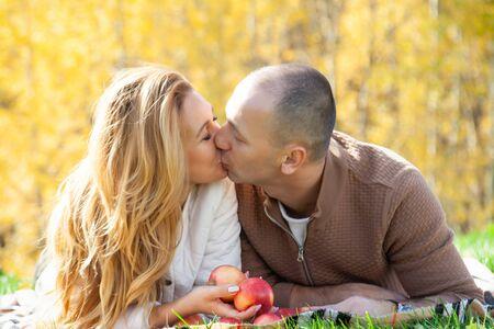 Happy couple in sunny autumn warm park