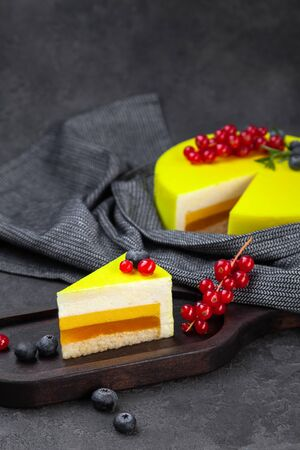 Souffle lemon layer yellow cake and piece on wooden plate