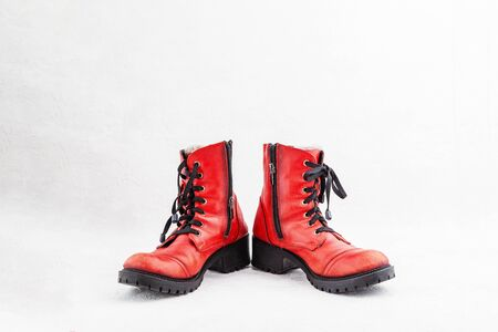 Pair of old leather red discarded boots with laces 版權商用圖片