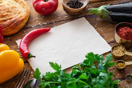 Pilaf ingredients on rustic surface with space for your recipe on paper
