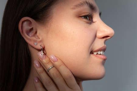 Beautiful jewelry model in modern silver round minimal earrings