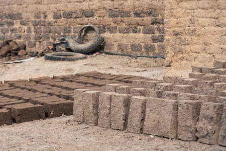Production of clay brick in stacks, bricks are arranged on one by one
