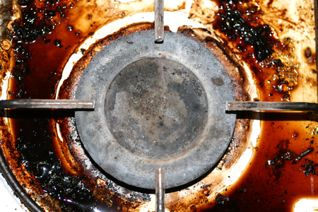 Dirty gas stove. The gas burner. Fat, rust on the surface Stock Photo
