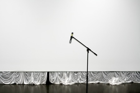 A high microphone on stage. Mocap. White background Фото со стока