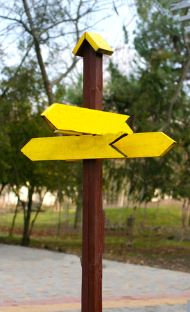 Wooden pointer of bright yellow color decorative.