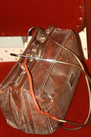 Old vintage doctor bag and phonendoscope. Rare stethoscope. Stock Photo