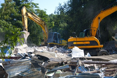 Stones, destroyed buildings, building. Demolition. A pile of stones. Crane