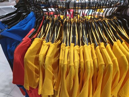 T-shirts are hanging in the store. Clothing store.