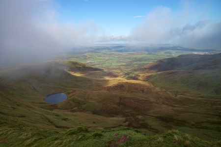 Panoramatic view of valley in Brecon Beacon in South Wales. Fogy autumn weather. Reklamní fotografie