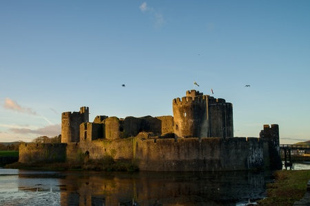 Carphilly Castle in South Wales. Medieval stronghold with moad.