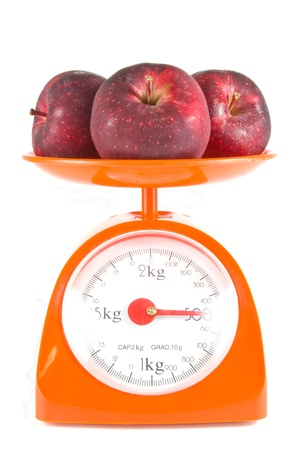 three apples lying on weight scale Stock Photo - 11171300