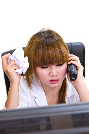 business woman is speaking on the phone at the office
