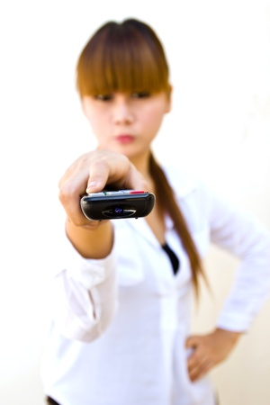 woman with remote control close-up focused on remote control