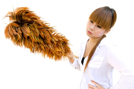 Woman boring holding an chicken feather duster