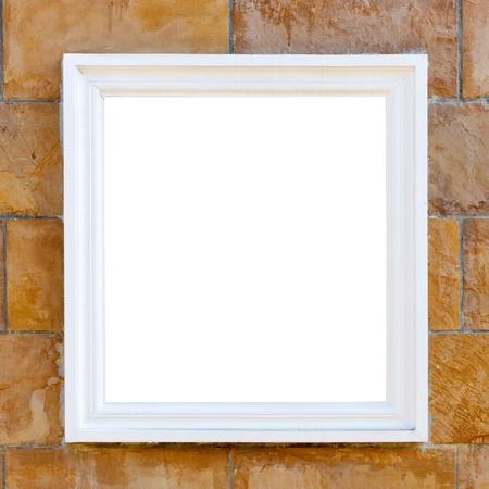 big white frame on brick wall photo