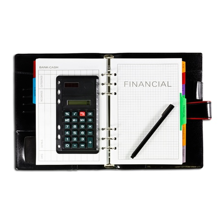 financial diary with pen Фото со стока