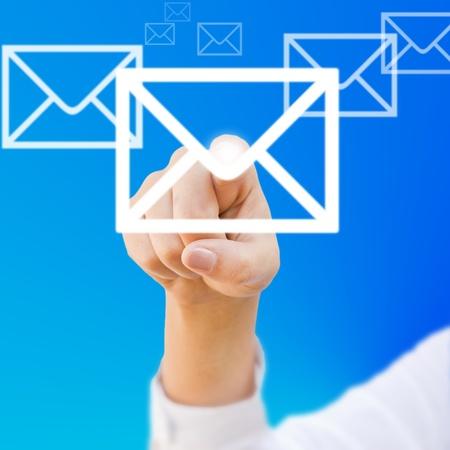 finger choosing mail symbol on blue background