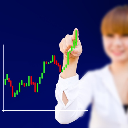 businesswoman drawing a business graph