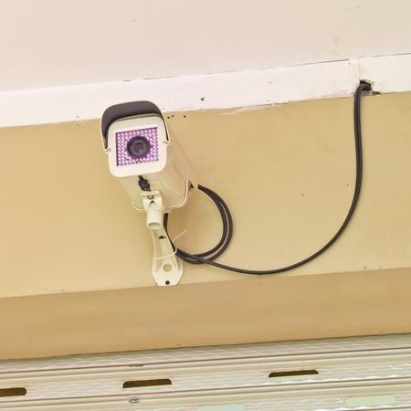 cctv camera on wall in nighttime photo