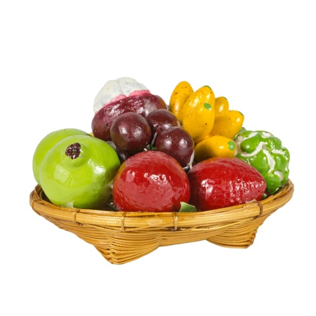 small toy mix fruit in basket photo