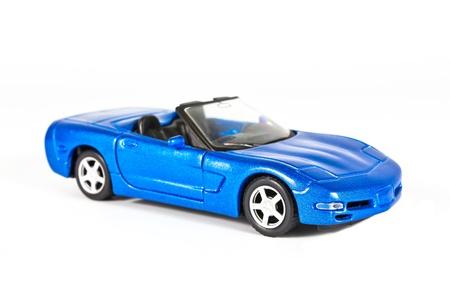 a blue sports car miniature on white background photo