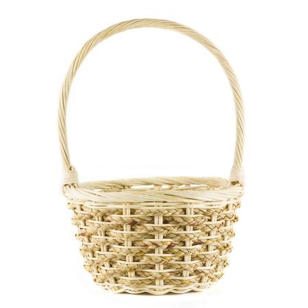 cepelia: a wicker basket on white backkground