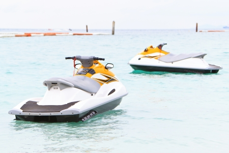 Yellow jet skis in the sea