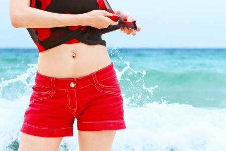 Young beautiful woman enjoying in beach Stockfoto