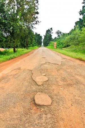 Dilapidated asphalt road in asia country photo