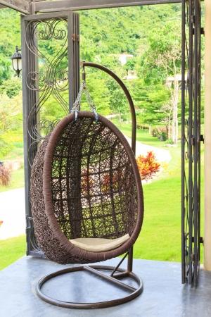 Modern brown chair in garden photo
