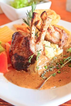 Lamb steak in white dish