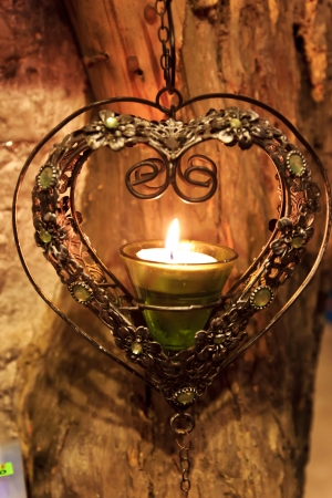 a candle in heart frame Фото со стока
