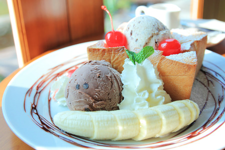 Honey toast with banana, maple syrup and ice cream photo