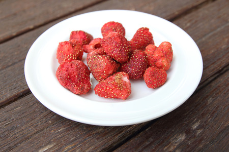 freeze: Freeze dired strawberries on wooden tabel Stock Photo