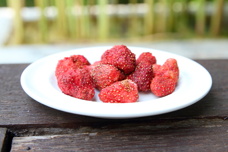 tabel: Freeze dired strawberries on wooden tabel Stock Photo