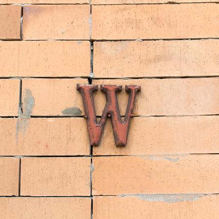 latrine: steel textured alphabet W