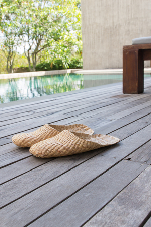 foot ware: Vintage slippers handmade with bamboo on wood floor