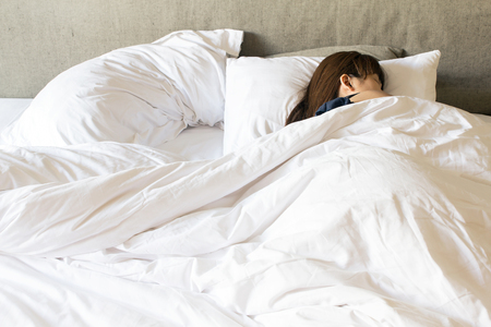 Pretty young woman sleeping while lying on bed