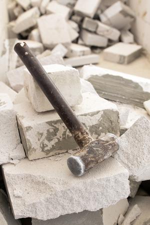 smashing: Old steel hammer smashing on broken brick wall