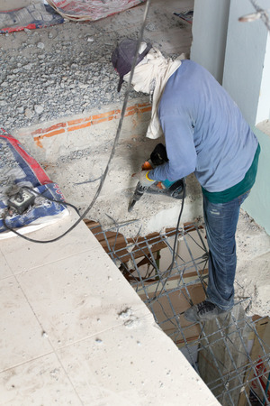 jack tar: Builder destroys  cement stairs with jackhammer Stock Photo