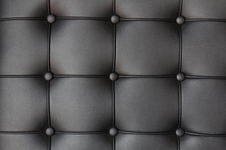 Background of luxury buttoned black leather Stockfoto