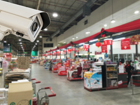 counter service: The CCTV Security Camera operating in counter service cashier at supermarket store blur background.