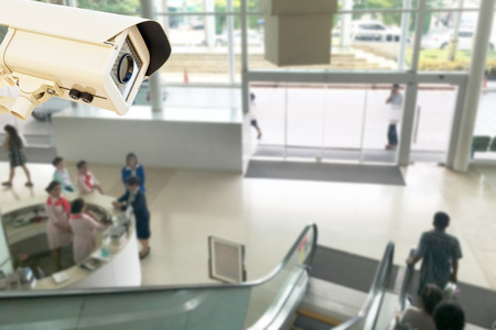 public hospital: The CCTV Security Camera operating in center public relations hospital blur background.