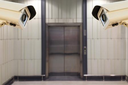 windlass: The CCTV Security Camera operating front elevator transport  blur background. Stock Photo