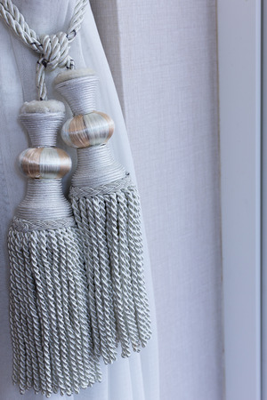 yellow tassel: Luxury curtain gray with clipping path in luxury room.