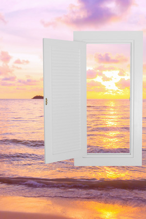 beach window: White window open frame with sunset beach background, concept background, idea background.