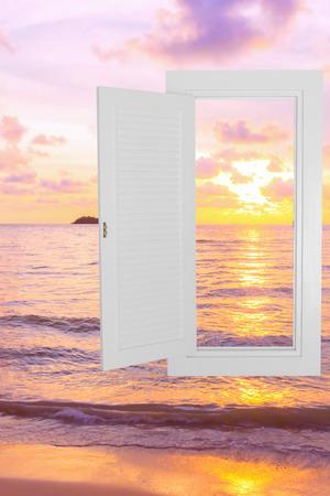 beach window: White window open frame with sunset beach background, concept background, idea background.