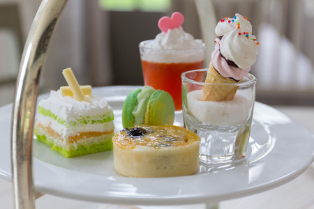 strawberry jam sandwich: Luxury afternoon tea with dessert on wooden table.